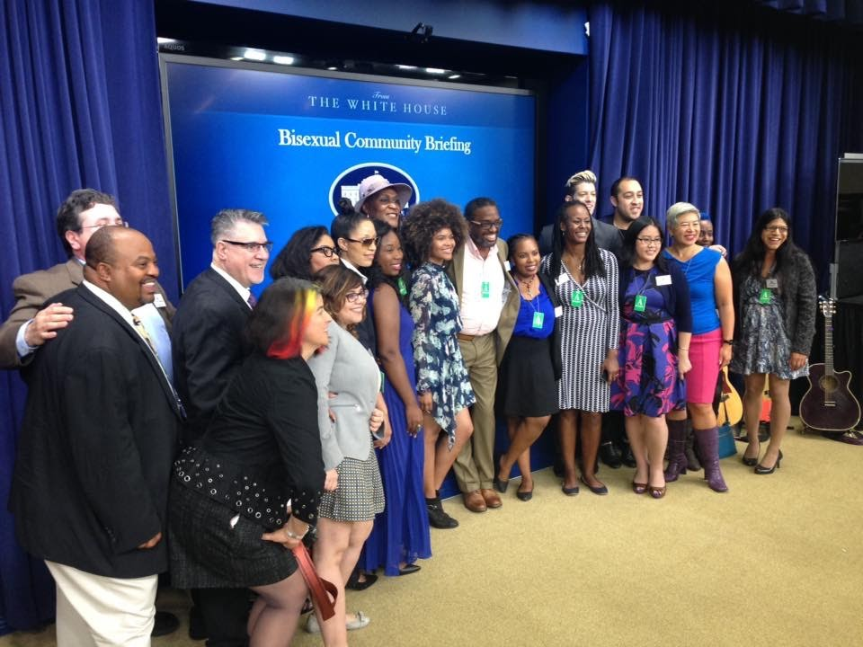 A group photo of people of color posing at the Bisexual Community Briefing at The White House.